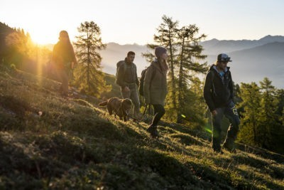 friends group sunny hike in mountains alps from peaks place hiking hotel laax